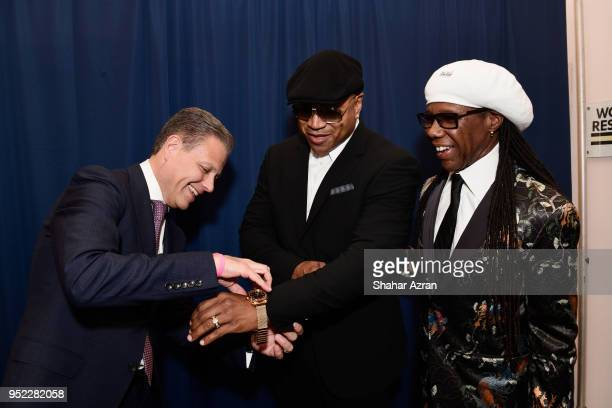 Managing DirectorBulova US Caribbean Latin American Markets at Bulova Corp Michael Benavente LL Cool J and Nile Rodgers poses in the Bulova booth...