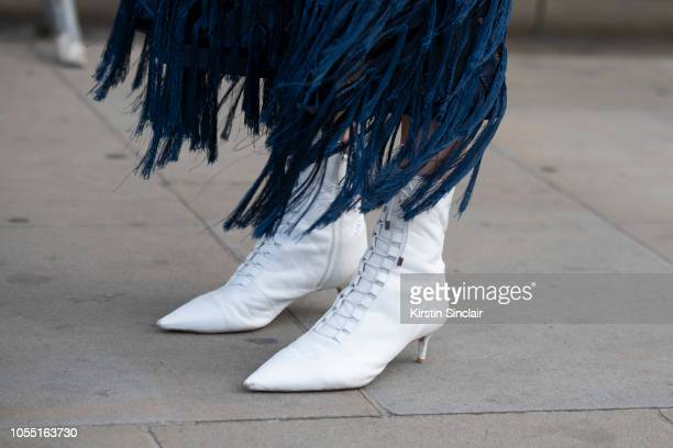 Managing Editor Abigail Gurney Read wears a Xu Zhi skirt and Alexandre Birman boots during London Fashion Week September 2018 on September 15 2018 in...