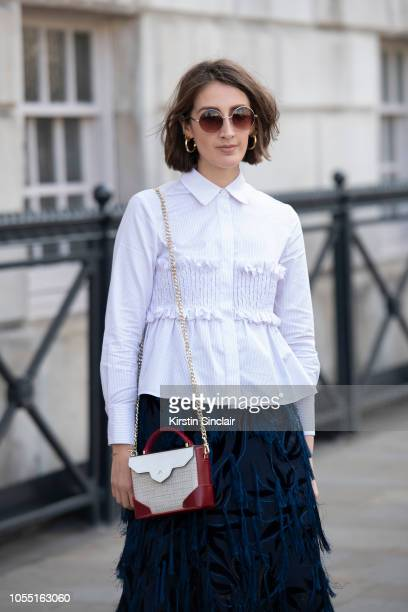 Managing Editor Abigail Gurney Read wears a Xu Zhi top and skirt Manu Atelier bag and Maria Black jewellery during London Fashion Week September 2018...