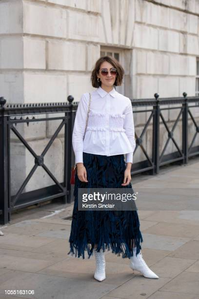 Managing Editor Abigail Gurney Read wears a Xu Zhi top and skirt Alexandre Birman boots and Maria Black jewellery during London Fashion Week...