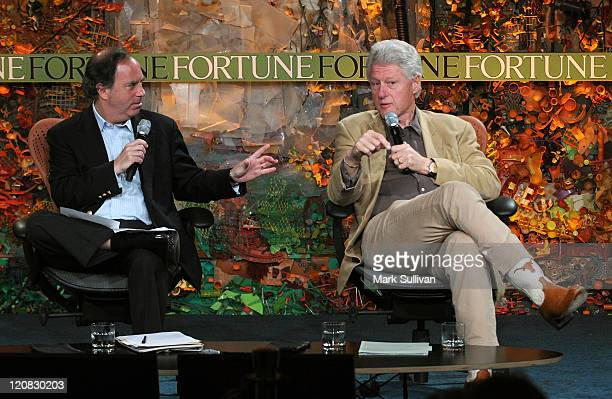 Managing editor of Fortune magazine Andy Serwer and former President Bill Clinton speak on stage at the Fortune Brainstorm Green conference at the...