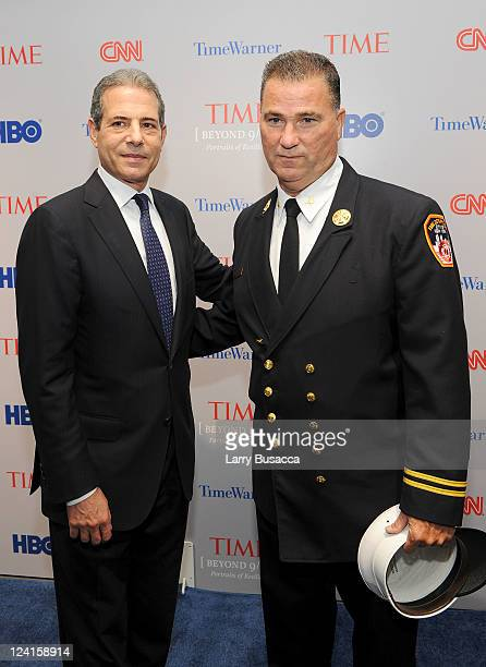 TIME managing editor Richard Stengel and retired deputy chief New York City fire department Jim Riches attend Time Warner's Beyond 9/11 Photo Exhibit...