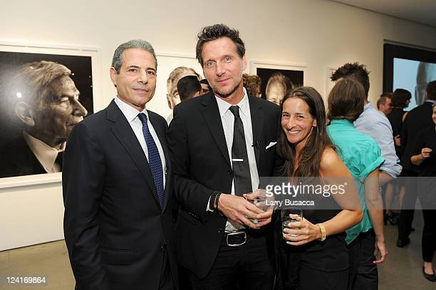 TIME managing editor Richard Stengel photographer Marco Grob and Director of Photography for TIME Kira Pollack attend Time Warner's Beyond 9/11 Photo...