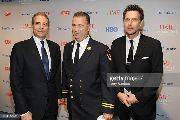 TIME managing editor Richard Stengel retired deputy chief New York City fire department Jim Riches and photographer Marco Grob attend Time Warner's...