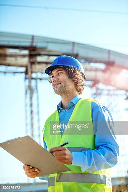 Managing engineer signes new project document