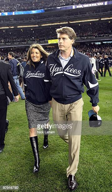 Managing General Partner Hal Steinbrenner of the New York Yankees and his wife Christina walk on the field after the Yankees won 73 against the...