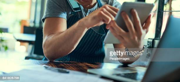 Managing his coffee shop the smart way