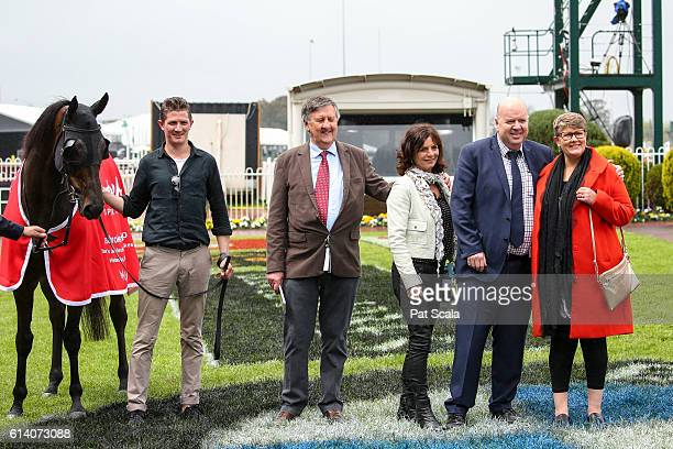 Managing owner John Clark [2nd L] with connections after Ferro Nero won Ladbrokes Handicap at Caulfield Racecourse on October 12 2016 in Caulfield...