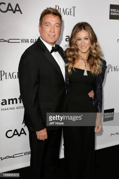 Managing Partner Kevin Huvane and actress Sarah Jessica Parker arrive at amfAR's Inspiration Gala at Milk Studios on October 11 2012 in Los Angeles...