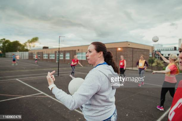 managing the netball game - referee stock pictures, royalty-free photos & images