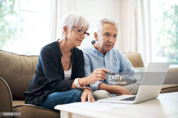 managing their finances online - bank statement stock pictures, royalty-free photos & images