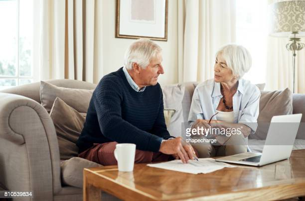managing their money through their retirement - home finances stock photos and pictures