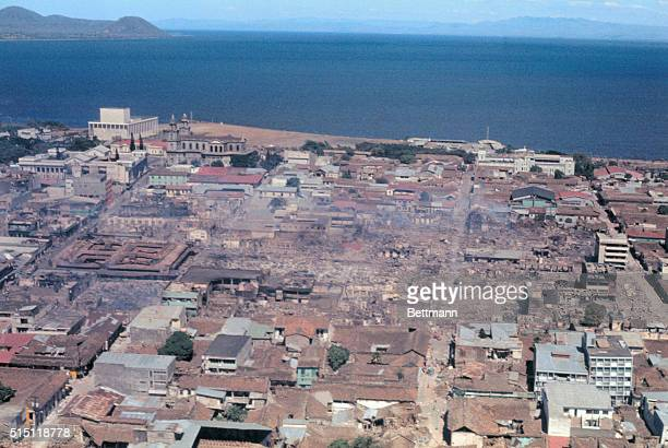 Aerial view shows wide spread damage to this capital city almost completely devastated by a series of earthquakes which began December 23 Buildings...