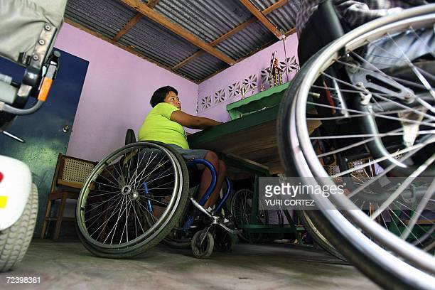 Ricardo Aleman's wife Zayda Paz a veteran of the Sandinista Popular Army is seen in her wheelchair as she listens to her husband who speaks about...