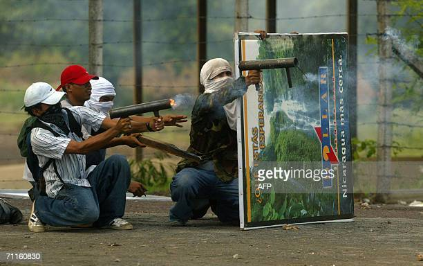 Students from the Central American University fire handcraft mortars against antiriot policemen next to the university in Managua 08 June 2006 during...