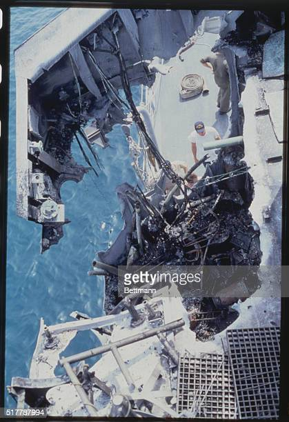 A gaping hole in the USS Stark is examined by rescue team after the frigate was hit by an Iraqi missile in the Persian Gulf