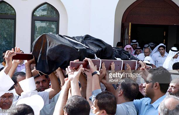 Mourners carry the body of Ahmad Dhawadi 8 July 2006 in Manama The former chief of the communist Bahraini National Liberation Front died today at the...
