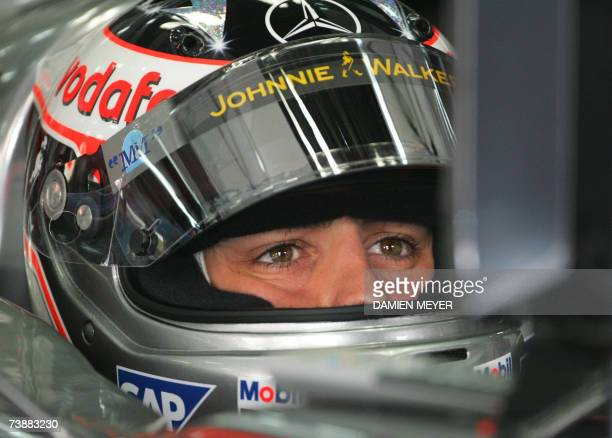 Spanish McLaren-Mercedes driver Fernando Alonso sits in his car in the pits of the Sakhir racetrack, 14 April 2007 in Manama, during the third...