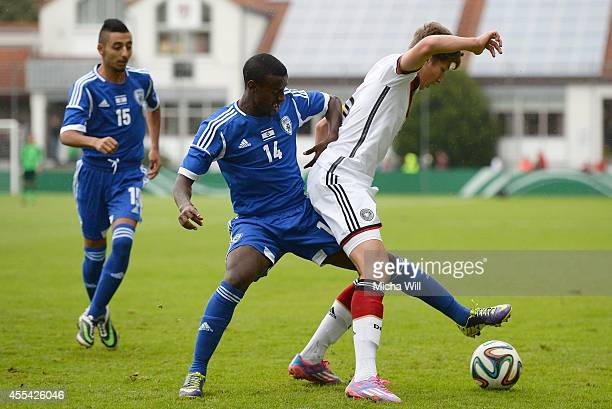 Manamto Asefa of Israel challenges Vitaly Janelt of Germany during the KOMM MIT tournament match between U17 Germany and U17 Israel on September 14...