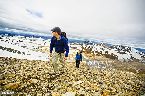 Manand woman hiking near Reykjavik, Iceland.