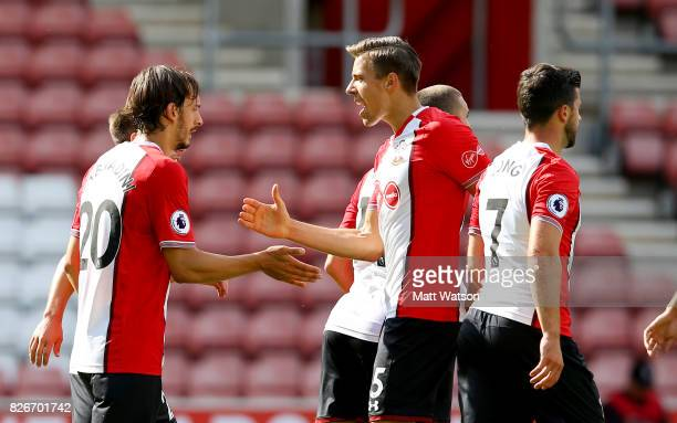 Manaolo Gabbiadini celebrates with Jan Bednarek of Southampton during the preseason friendly between Southampton FC and Sevilla at St Mary's Stadium...