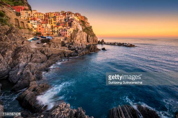 manarola, cinque terre (italian riviera, liguria) amazing beautiful view at twilight - french riviera stock pictures, royalty-free photos & images