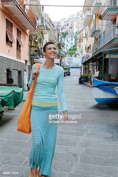 manarola italy vacation - older women in short skirts stock pictures, royalty-free photos & images