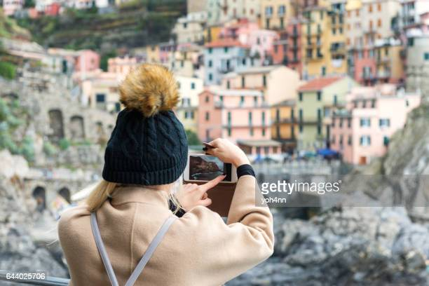 Manarola - woman capturing photo on phone