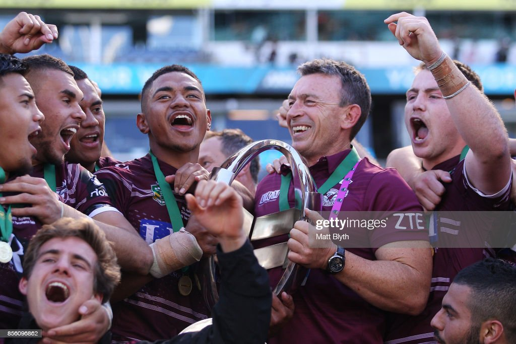 Manase Fainu of the Sea Eagles and coach Wayne Lambkin celebrate after winning the 2017 Holden Cup Grand Final match between the Manly Sea Eagles and the Parramatta Eels at ANZ Stadium on October 1, 2017 in Sydney, Australia.