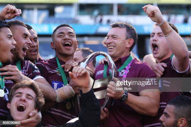 Manase Fainu of the Sea Eagles and coach Wayne Lambkin celebrate after winning the 2017 Holden Cup Grand Final match between the Manly Sea Eagles and...