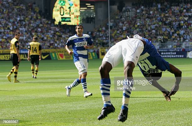Manaseh Ishiaku of Duisburg celebrates after scoring the first goal during the Bundesliga match between Borussia Dortmund and MSV Duisburg at the...