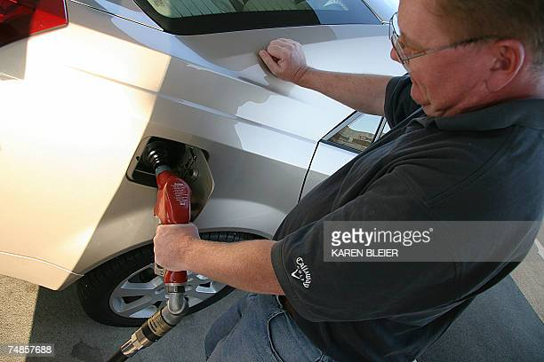 Manassas, UNITED STATES: A man pumps gasoline into his car 21 June, 2007 in Manassas, Virginia. The Senate passed an energy bill late Thursday that...