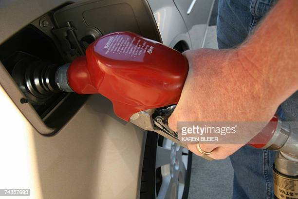 A man pumps gasoline into his car 21 June 2007 in Manassas Virginia The Senate passed an energy bill late Thursday that includes an increase in...