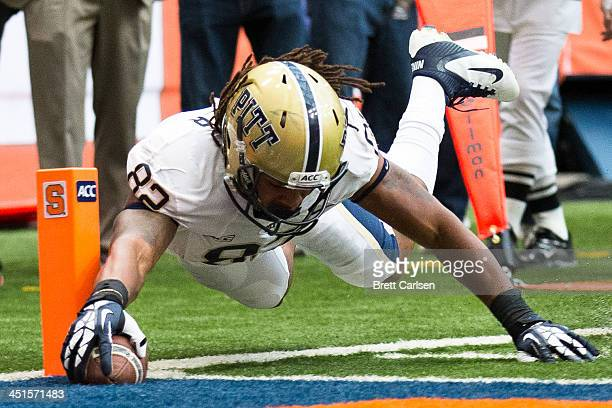 Manasseh Garner of the Pittsburgh Panthers dives into the end zone for a touchdown in the first half of a football game against Syracuse Orange on...