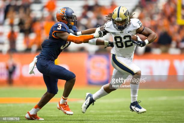 Manasseh Garner of the Pittsburgh Panthers fends off Durell Eskridge of the Syracuse Orange during a third quarter reception on November 23 2013 at...