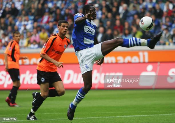 Manasseh Ishiaku of Duisburg controls the ball next to Andre Mijatovic of Bielefeld during the Bundesliga match between MSV Duisburg and Arminia...