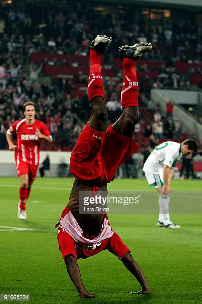 Manasseh Ishiaku of Koeln celebrates scoring his team's first goal during the DFB Cup second round match between 1 FC Koeln and VfL Wolfsburg at...