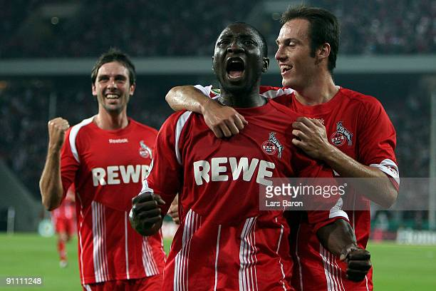 Manasseh Ishiaku of Koeln celebrates scoring the second goal with team mates Fabrice Ehret and Sebastian Freis during the DFB Cup second round match...