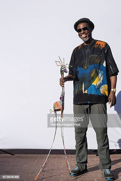 Manatho Shumba Masani who makes sculptures of giraffes and other animals out of aluminum cans stands for a Just Asking portrait next to his booth at...