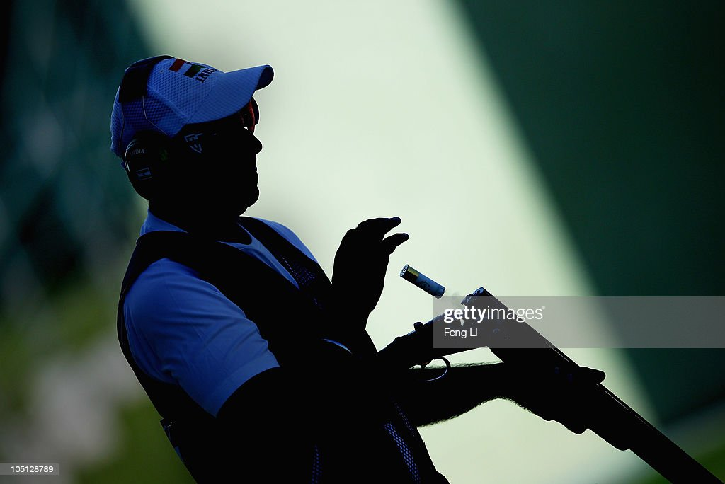 Manavjit Singh Sandhu of India completes in the Men's Singles Trap final at the Dr Karni Singh Shooting Range during day seven of the Delhi 2010 Commonwealth Games on October 10, 2010 in Delhi, India.