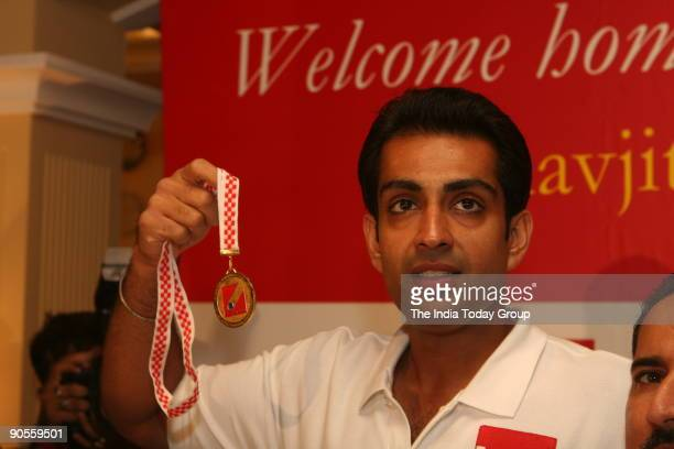 Manavjit Singh Sandhu with his Gold medal which he has won in 49th Shooting World Championship in Croatia At Imperial hotel during a felicitation...