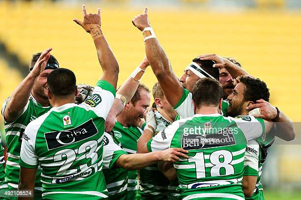 Manawatu players celebrate the win at the final whistle during the round nine ITM Cup match between Wellington and Manawatu at Westpac Stadium on...