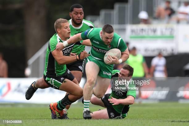 Manawatu's Cameron Black is tackled during the TECT National Sevens Mens Shield Final match between South Canterbury and Manawatu at Tauranga Domain...