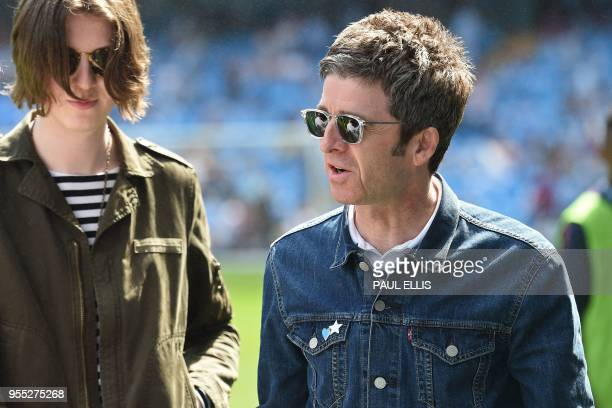 Manc hester City fan singer Noel Gallagher is pictured on the pitch before the English Premier League football match between Manchester City and...