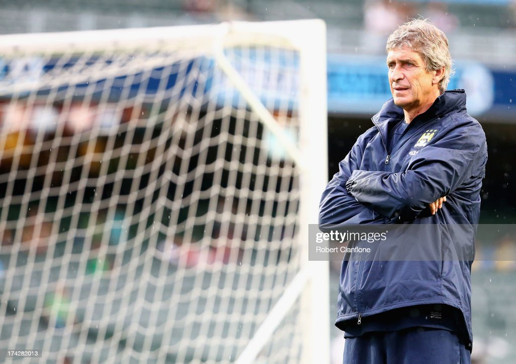 Mancester City coach Manuel Pellegrini looks on Barclays Asia Trophy training session at Hong Kong Stadium on July 23, 2013 in So Kon Po, Hong Kong.