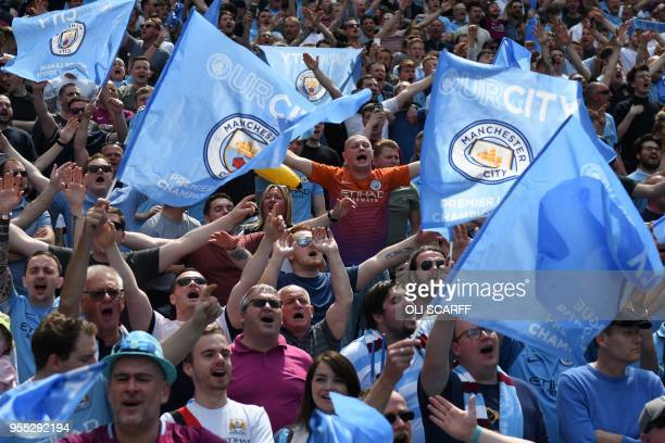 Mancester City fans wave flags during during the English Premier League football match between Manchester City and Huddersfield Town at the Etihad...