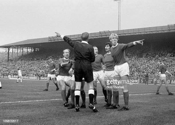 Mancester United players left to right Bobby Charlton Nobby Stiles Tony Dunne and Ian Ure question referee Mr D W Smith during their Division One...