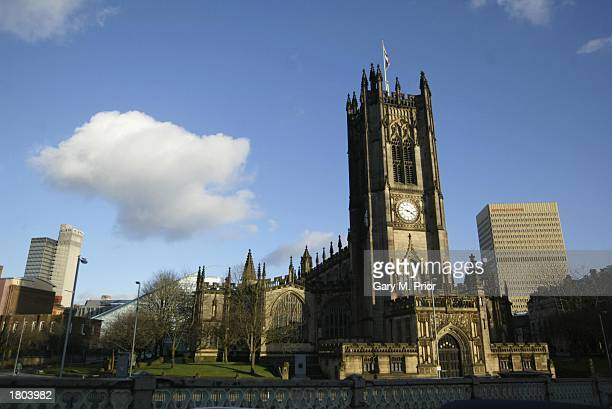 Manchester Cathedral with the Arndale Centre the site of an IRA bomb blast in 1996 in Manchester England on February 9 2003