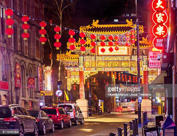 manchester, chinatown by night - chinatown stock photos and pictures