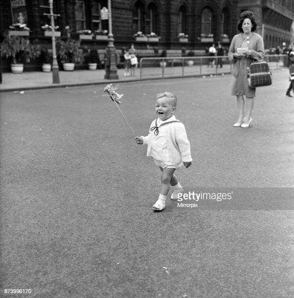 Manchester Church of England Whit Monday walks Jimmy Haye aged 18 months runs out to cheer his three sisters who walked with the Girls Brigade from...